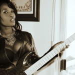 Sabine Mondestin picture with rock guitar